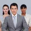 Multi-ethnic business team sitting in front of the camera — Stock Photo