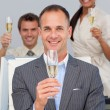 Multi-ethnic business co-workers toasting with Champagne — Stock Photo
