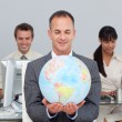 Stock Photo: Assertive manager smiling at global expansion