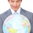 Confident businessmholding terrestrial globe — Stock Photo #10286192