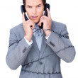 Angry businessman tangle up in phone wires — Stock Photo #10286212