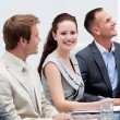 Beautiful businesswoman smiling in a meeting — Stock Photo