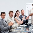 Foto Stock: Business applauding a colleague after giving a presentati