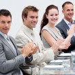 Business team applauding in a meeting - Stock Photo