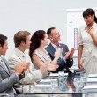 Business team applauding a colleague after giving a presentation — Stock Photo #10286307