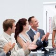 Business applauding a colleague after giving a presentati — ストック写真