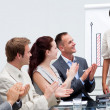 business applauding a colleague after giving a presentati — Stock Photo