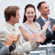 Attractive businesswoman applauding in a meeting — Stock Photo