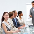 Beautiful businesswoman in a presentation — Stock Photo #10286328
