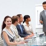 Beautiful businesswoman in a presentation — Stock Photo