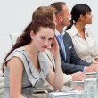 Businesswoman getting tired in a meeting — Stock Photo