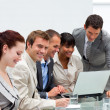 Attractive businessman working with his team — Stock Photo