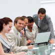 Attractive businessman working with his team — Stock Photo #10286342