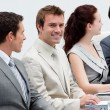 Attractive businessman smiling in a meeting — Foto de Stock