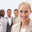 Portrait of smiling businesswoman in front of her team — Stock Photo #10286392