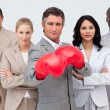 Confident businessman boxing and leading his team — Stock Photo #10286407