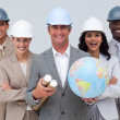 Enginner team holding a terrestrial globe — Stock Photo