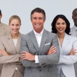Confident business team standing and smiling — Stock Photo