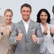 Confident business team with thumbs up — 图库照片