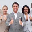 Confident business team with thumbs up — ストック写真
