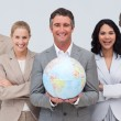Стоковое фото: Business team holding terrestrial globe