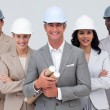 Architectural team smiling at camerwith hard hats — Stock Photo #10286430