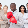 Afro-American businessman boxing and  leading his team — Stock Photo