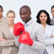 Stock Photo: Afro-American businessman boxing and leading his team