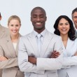 Smiling African businessman leading his team — Stock Photo