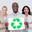 Business team holding a recycle symbol — Stock Photo