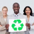 Business team holding a recycle symbol — Stock Photo #10286466