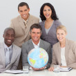 Business team holding a terrestrial globe — Stockfoto
