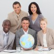 Foto Stock: Business team holding a terrestrial globe