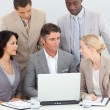 Multi-ethnic business team working in office together — Stock Photo