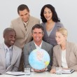 Business team holding terrestrial globe — Photo #10286495