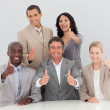 Happy business team celebrating a success with thumbs up — Stock Photo
