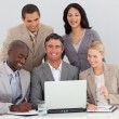 Smiling multi-ethnic business team working in office together — Stock Photo