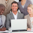Happy manager working with his team — Stock Photo