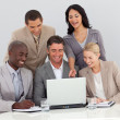 Multi-ethnic business team studying sales figures — Stock Photo