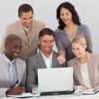 Multi-ethnic business team working in office together — Stock Photo #10286532