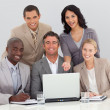 Multi-ethnic business team working in the office — Stock Photo #10286533