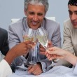 Close-up of a happy architectutal team toasting with champagne — Stock Photo #10286549