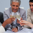 Close-up of a happy architectutal team toasting with champagne — Stock Photo