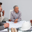 Architects in a meeting studying plans — Stock Photo