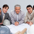 Smiling architects in a meeting studying plans — Stock Photo
