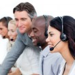 Charismatic manager and his team working in a call center — Stock Photo #10286588