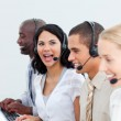 Laughing businesswoman and her team working in a call center — Stock Photo