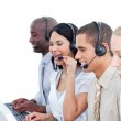 Laughing woman and her team working in a call center — Stock Photo #10286611