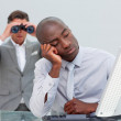 Unhappy businessman getting bored and his manager looking throug — Stock Photo
