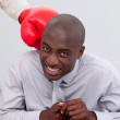 Portrait of an Afro-American businessman being boxed — Stock Photo
